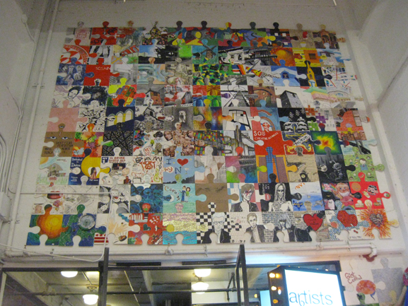 puzzle art installation and collaborative project chelsea market tim kelly artists and fleas indie art market nyc art